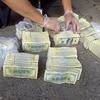 На боливийских полицейских упал с неба миллион долларов