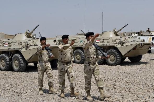 Военное положение: Одежда и аксессуары солдат в Ираке. Изображение № 64.