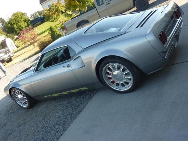 Американская мастерская изготовила гибрид маслкара Ford Mustang Mach 1 и спорткара GT40. Изображение № 2.
