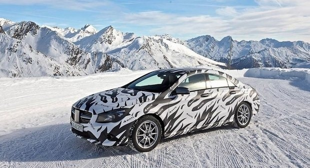 Mercedes показали новый закамуфлированный спортивный седан. Изображение № 5.