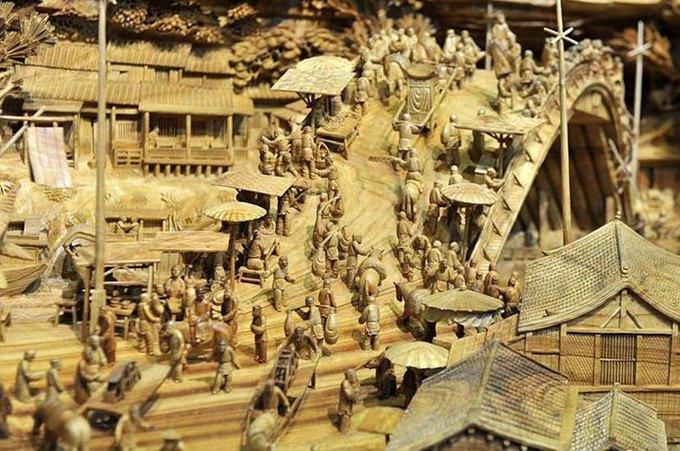 Китайский мастер попал в «Книгу рекордов Гиннесса» за самую длинную скульптуру из дерева. Изображение № 4.