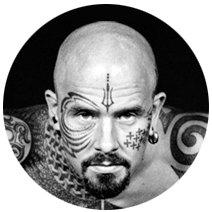 На лбу написано: Путеводитель по татуировкам на лице. Изображение №10.