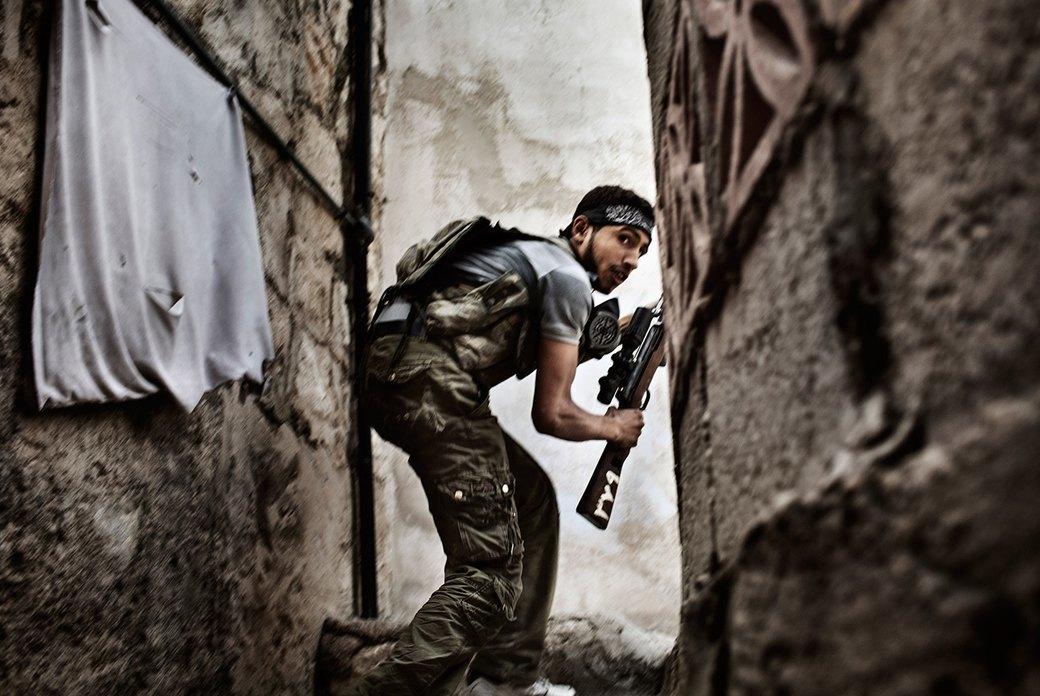 Объективный взгляд: 10 современных военных фотографов . Изображение № 46.