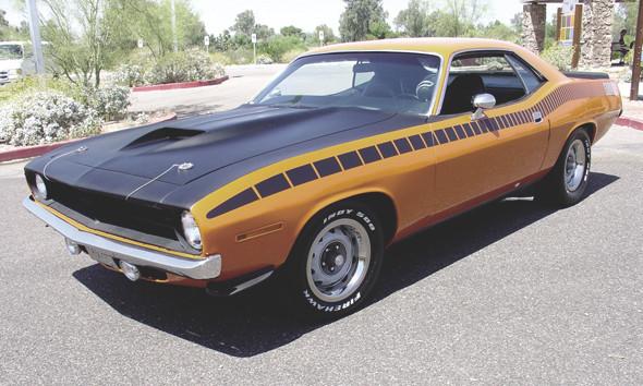 Компания Chrysler перевыпустит культовый маслкар Plymouth Barracuda. Изображение №2.