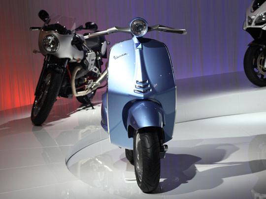 Новая модель мотороллера марки Vespa. Изображение №1.