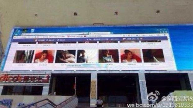 На рекламном дисплее в центре китайского города показали порно. Изображение № 1.
