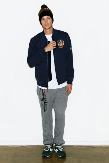 Марка Undefeated выпустила лукбук новой коллекции одежды своей линейки Holiday. Изображение №9.