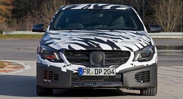Mercedes показали новый закамуфлированный спортивный седан. Изображение № 11.