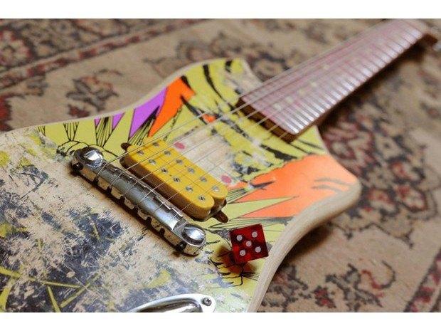 Аргентинская мастерская создает электрогитары из старых скейтбордов. Изображение № 2.