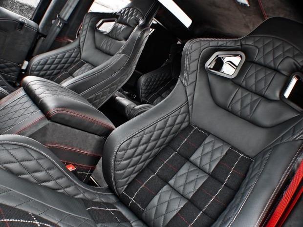 Британское ателье представило внедорожник Land Rover, отделанный тканью Harris Tweed. Изображение № 4.