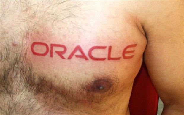 Индийские программисты делают себе татуировки с логотипами IBM и Microsoft. Изображение № 1.