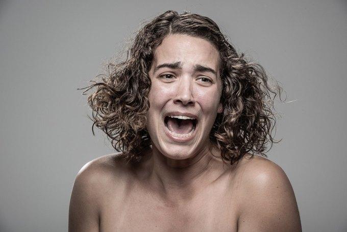 Фотограф снимал лица людей после удара шокером. Изображение № 20.