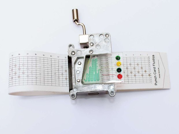 Punchcard Programmable Fluidics. Photo by George Korir via Popular Science. Image 1.