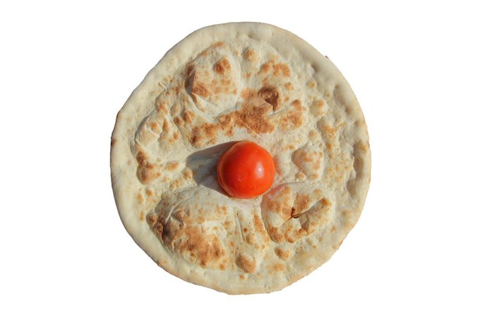 """IRL"" by Luc Fuller. Single tomato on plain pizza crust via Pizza Pavilion. . Image 5."