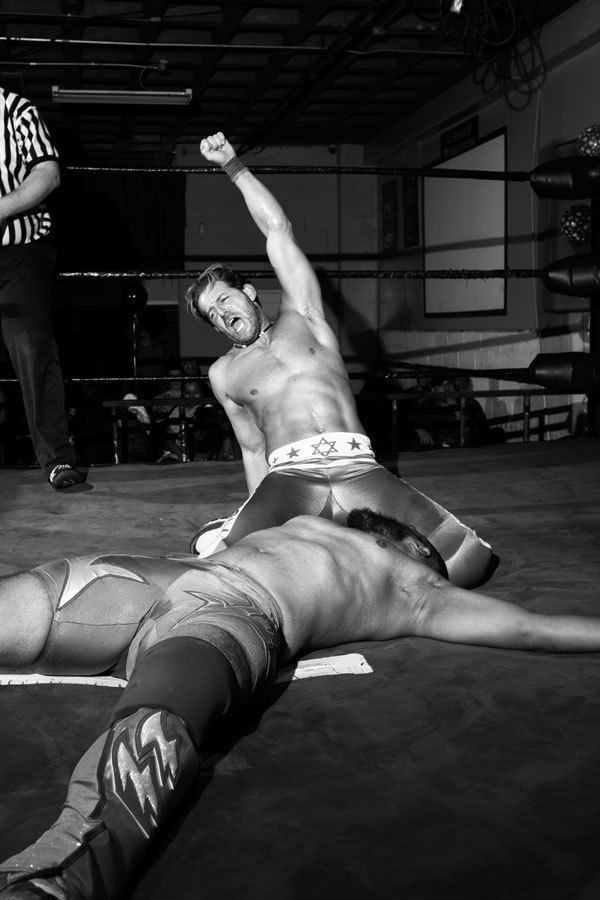 A wrestler who goes by Hawaii Allen celebrated the defeat of an oponent in a four-way match on November 7, 2015.. Image 10.