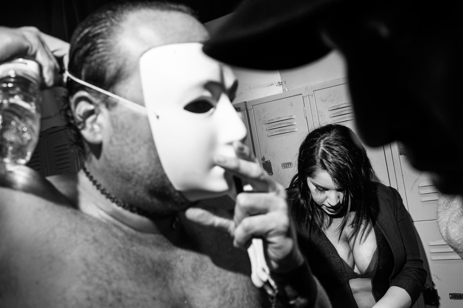 "Draven, the Embodiment of Sexiness and Arrogance, straps on a mask in the locker room before his match. ""Being a good guy in real life makes me better at turning into this cocky flamboyant asshole that everyone hates,"" he said.. Image 4."