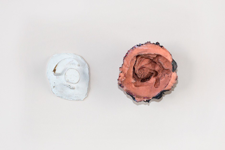 The positive plaster mold and negative silicone mold with a relief of the prototype ear design. Image 10.