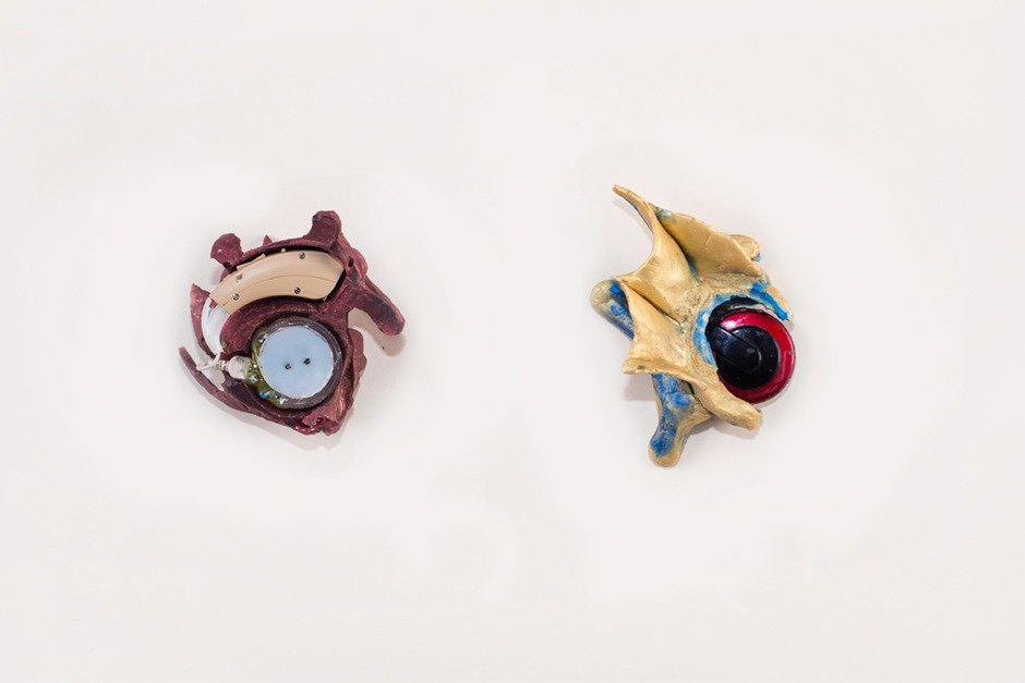 """Two final prototypes, a flower """"elf"""" ear and a gold dragon ear, made of silicone. Image 11."""