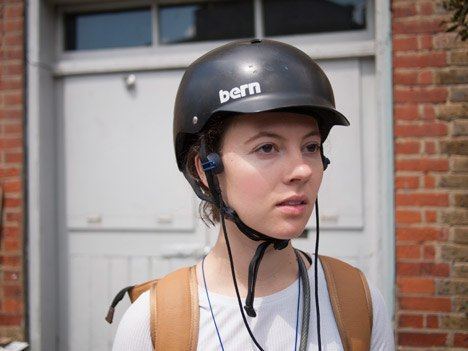 These headphones play music through your cheekbones while you bike. Image 2.