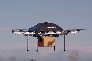 Amazon будет доставлять посылки с помощью дронов