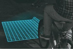 Велосипедная подсветка проецирует на дорогу сетку