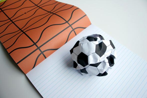 Бумажные мячи и книга, дающая огонь. Изображение № 3.