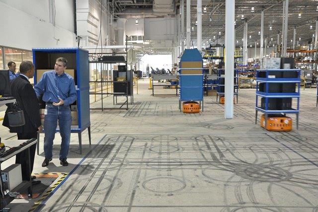 Рабочий цех Kiva Systems (роботы — оранжевого цвета). Изображение № 1.