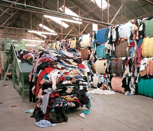 Склад, куда поступает одежда, переданная на recycling. Изображение № 16.