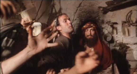В фильме «Жизнь Брайана по Монти Пайтон» в одной из сцен можно заметить продюсера картины Джорджа Харрисона. . Изображение № 17.
