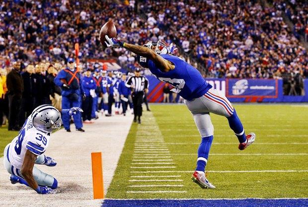 Оделл Бекхэм из New York Giants делает тачдаун одной рукой в матче против Dallas Cowboys / Автор: Al Bello. Изображение № 7.