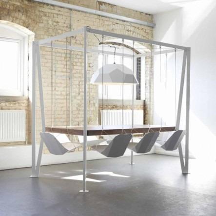 Британский дизайнер создал обеденный стол с качелями. Изображение № 1.
