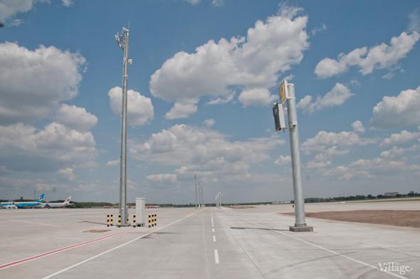 Фоторепортаж: В аэропорту Борисполь открыли самый большой на Украине терминал. Зображення № 37.