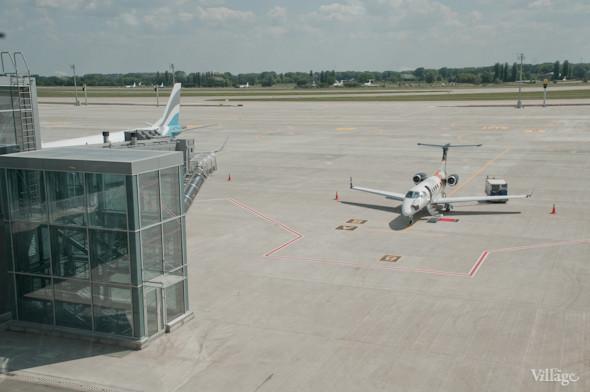 Фоторепортаж: В аэропорту Борисполь открыли самый большой на Украине терминал. Зображення № 32.