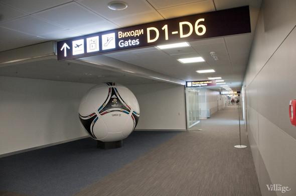 Фоторепортаж: В аэропорту Борисполь открыли самый большой на Украине терминал. Зображення № 23.