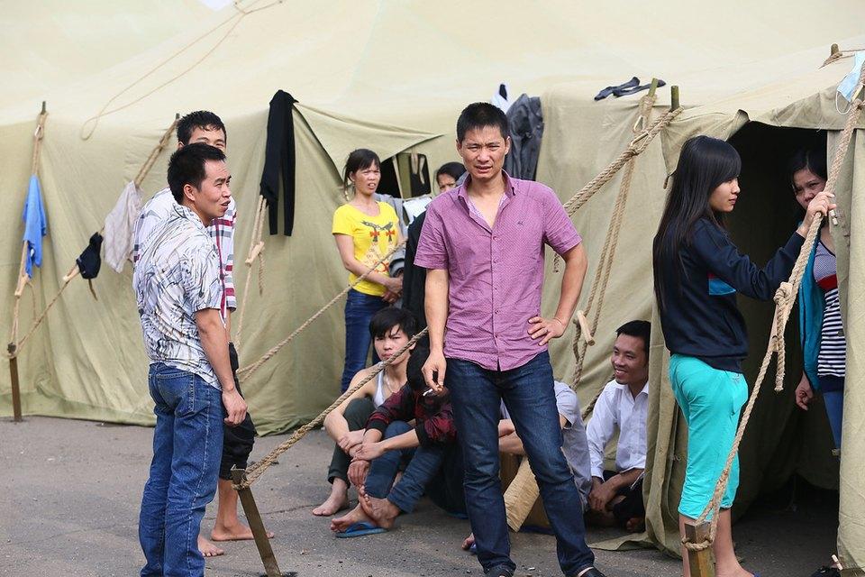 Фото дня: Палаточный лагерь для нелегальных мигрантов в Москве. Изображение № 8.