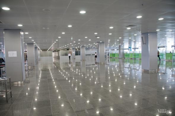 Фоторепортаж: В аэропорту Борисполь открыли самый большой на Украине терминал. Зображення № 10.