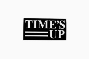 Значок кампании против сексуальных домогательств Time's Up