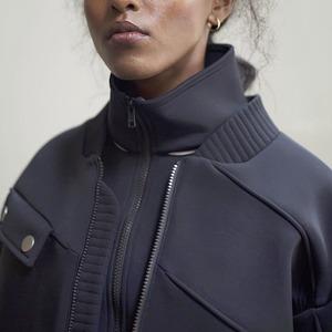 Лондонская марка Neoss: Вещи из неопрена и вельвета
